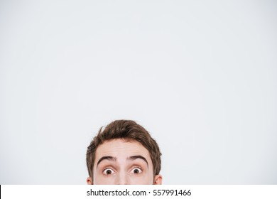 Man peeking out from the edge and looking at camera isolated on a white background