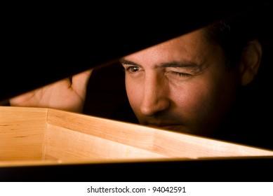 A man peeks into a box