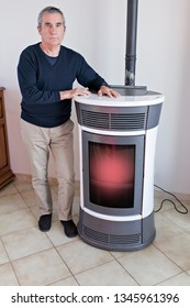 man and pellet stove