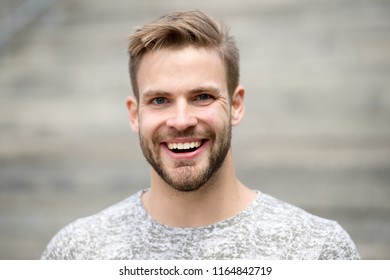 Man with perfect brilliant smile unshaven face defocused background. Guy happy emotional expression outdoors. Bearded and handsome. Man happy smiling face white brilliant teeth. Dentistry concept.