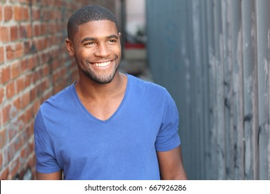 Man with a perfect white smile looking away