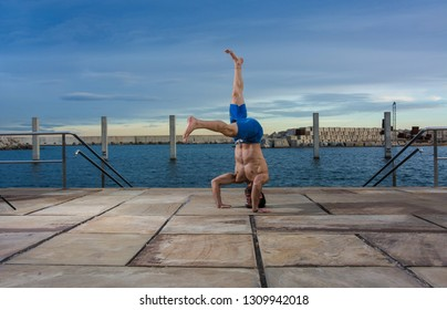Man performing advanced yoga exercises and stretching to keep the body healthy