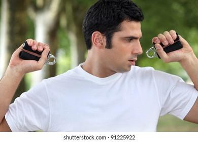 Man performing wrist exercise
