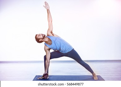 Man performing yoga in gym