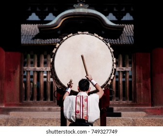 A man performs traditional Japanese Taiko drum.