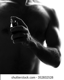 Man with perfume bottle