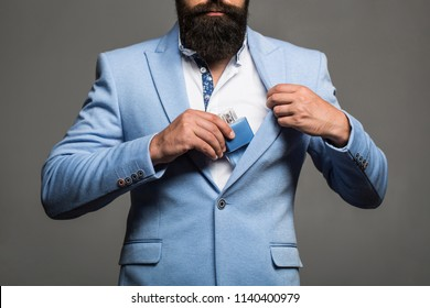 Man perfume, fragrance. Masculine perfume, bearded man in a suit. Male holding up bottle of perfume. Perfume or cologne bottle and perfumery, cosmetics, scent cologne bottle, male holding cologne.
