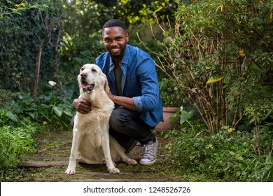 A man petting his dog