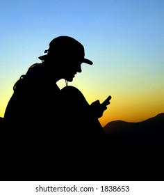Man with phone on the mountain