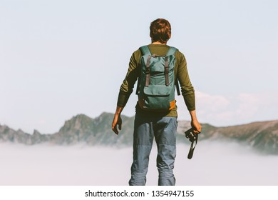 Man photographer traveling in mountains adventure lifestyle leisure weekend hillwalking outdoor with backpack