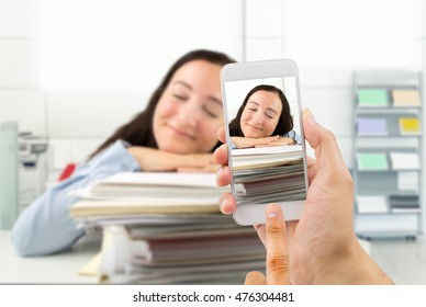 Man photographing an administrative employee asleep on the job to capture the moment and sending to the boss