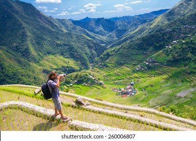 A man photographs the landscape. Rice terraces in the Philippines. Rice cultivation in the North of the Philippines, Batad, Banaue.