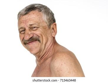 Man photoshooting shirtless in studio