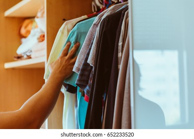 Man picking clothes from the closet