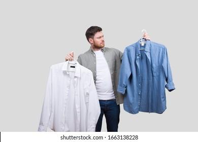 Man Picking Shirt. Man Decides Which Shirt to Wear