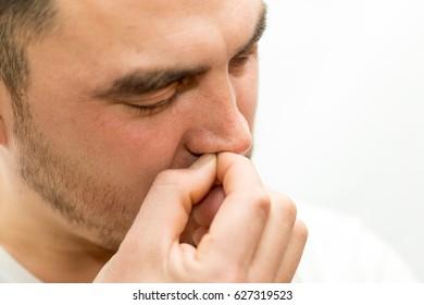 The man picks his nose