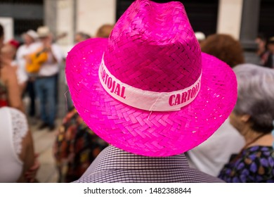 Man with pink hat having fun at the fair in Malaga, Cartojal, Malaga August 18, 2019