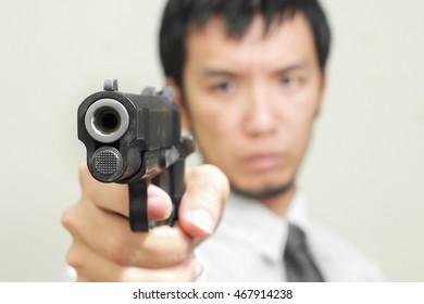 Man with pistol handgun weapon
