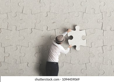 man places last piece of puzzle surreal concept