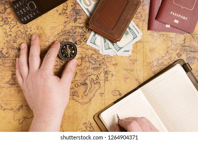 Man is planing his trip and prepearing equipment, money, route and documents