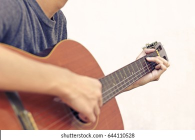 Man play classic guitar on white background.