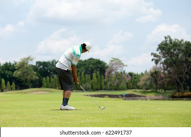 A man play golf at golf course in summer