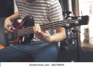 Man play on bass guitar