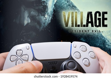 Man play Resident Evil Village demo on Playstation 5, 3 Mar  2021, Sao Paulo, Brazil.