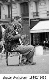 Man playing accordion in Paris, France on June 8, 2012