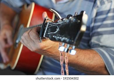 Man playing Acoustic guitar, closeup image