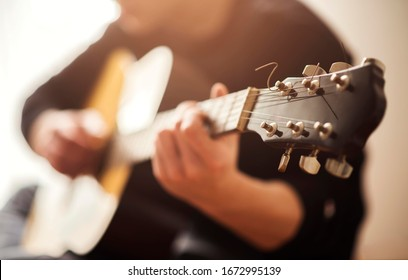 man playing acoustic guitar isolated.