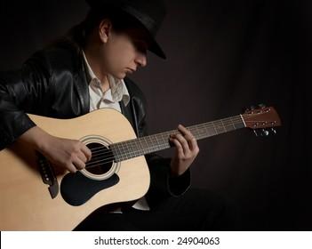 Man playing acoustic guitar at rock concert
