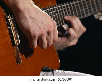 man playing acoustic guitar,useful for various music and entertainment themes