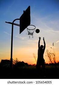 Man playing basketball - dark silhouette