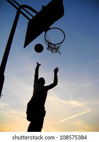 Man playing basketball - dark silhouette
