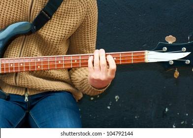 Man playing bass guitar during on street