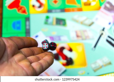 Man playing a Board game. The dice at the time of the roll.