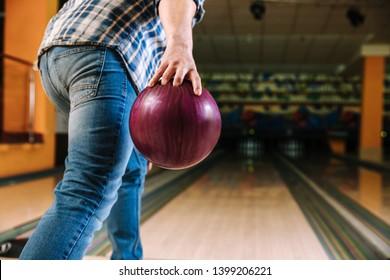 Man playing bowling in club