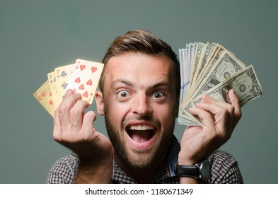 man with playing cards and money