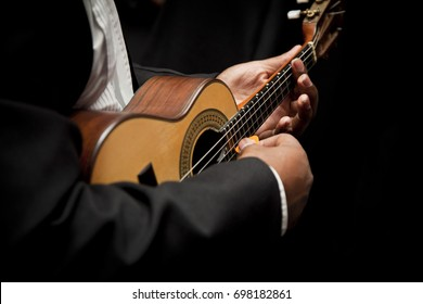 Man playing cavaquinho, Brazilian instrument used to play samba