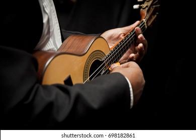 Man playing cavaquinho, Brazilian instrument used to play samba