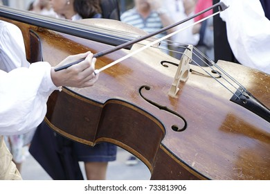Man playing the cello in a parade