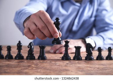 Man playing chess. Competition strategy concept