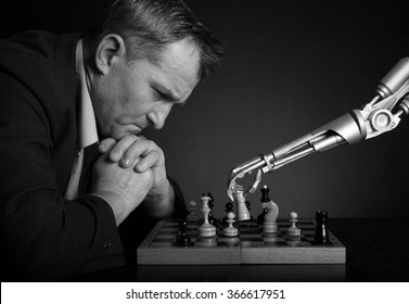A man playing chess with a robot.