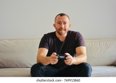 man playing console games