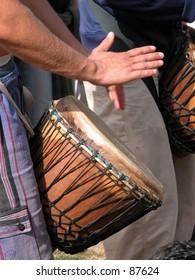 Man playing the djembe (nigerian drum)