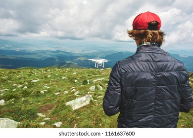 man playing with the drone. drone quadcopter with digital camera in the mountains. The drone with camera takes pictures of the misty mountains. quadcopter drone flying with digital camera on the sky.