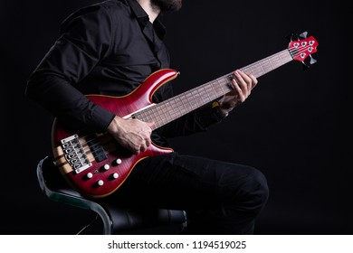 Man Playing Electric Bass Guitar with Slap Technique