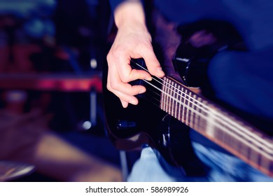 Man playing electric guitar. Music, instrument education, entertainment, rock star, music concert and learning concept