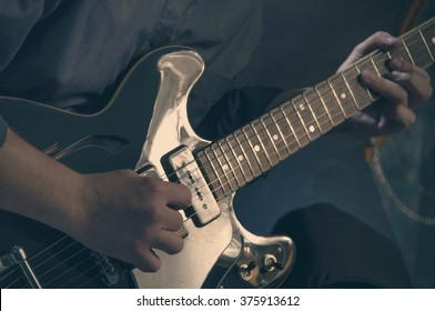 Man playing electric guitar in studio - 4